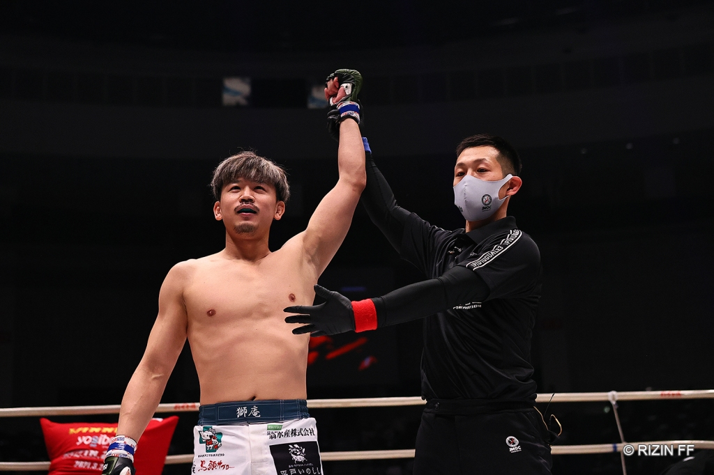 Shian gets his arm raised after a win