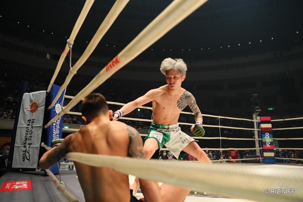 Yuki Ito charges at Kohei Sugiyama after scoring a knockdown.