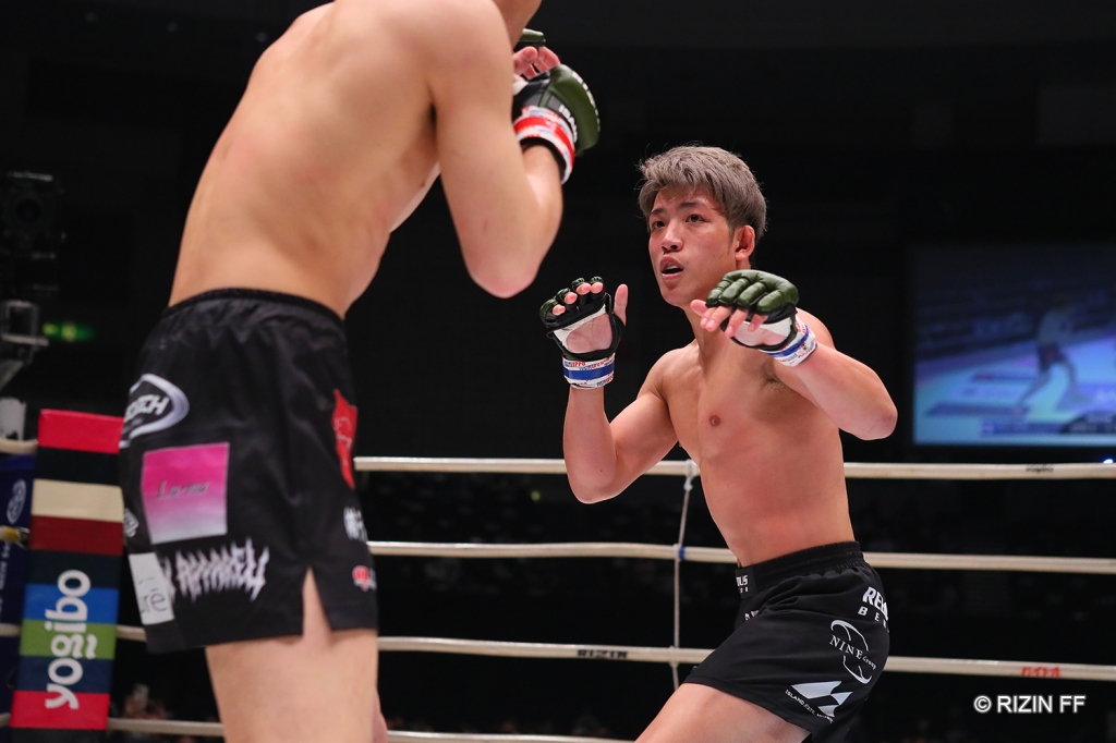 Yoshinori Horie has his hands ready while striking with Tetsuya Seki
