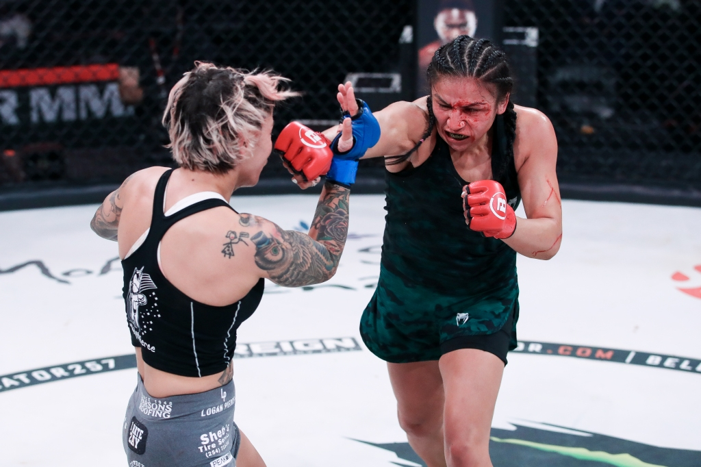 Veta Arteaga throws a right hand at Desiree Yanez, who has her right arm up to defend.