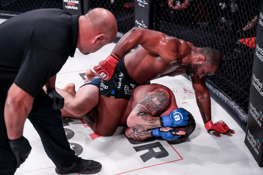 Tyrell Fortune lands punches to the head of Jack May while on his back.