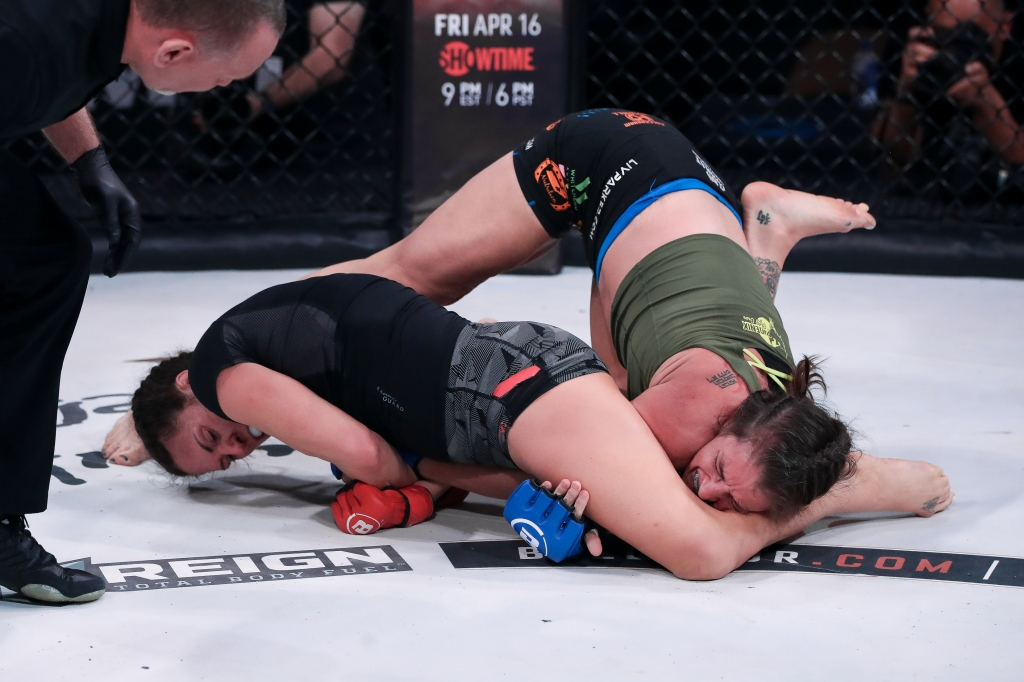 Cat Zingano attempts to extend the arm of Olivia Parker for an armbar.