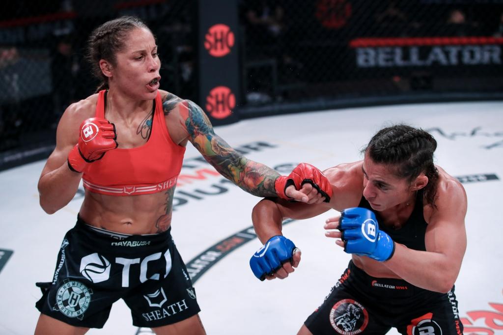 Liz Carmouche throwing a left hand at Vanessa Porto