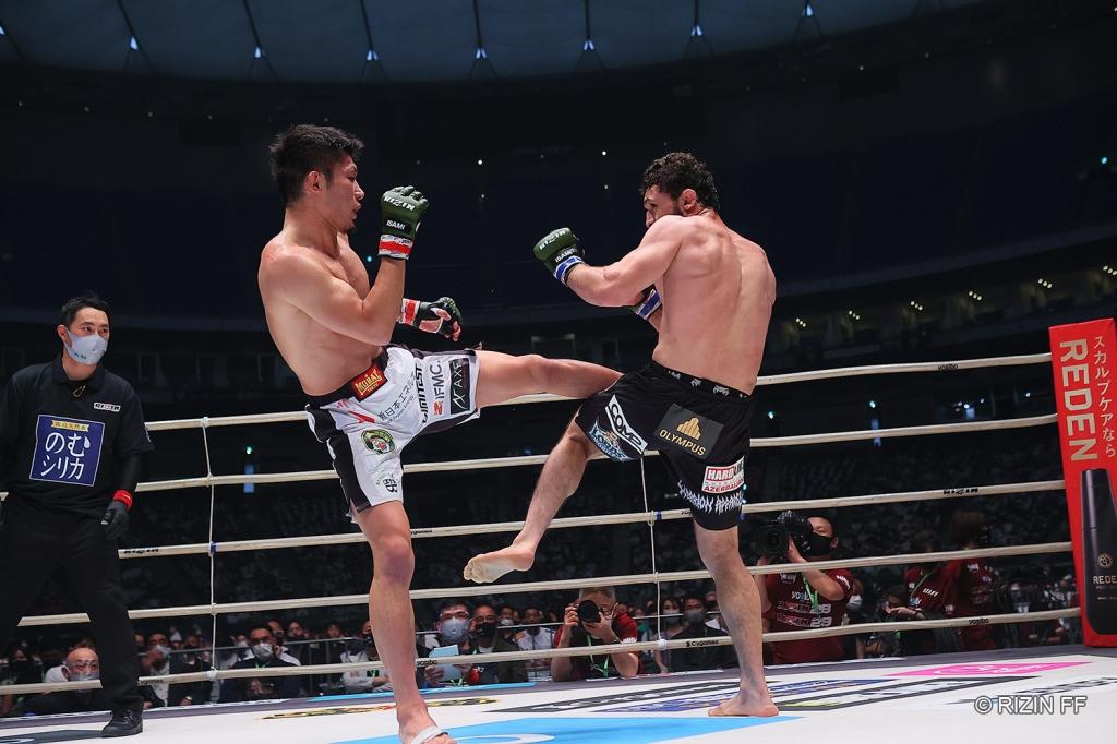 Yutaka Saito throws a kick to the body of Vugar Karamov.