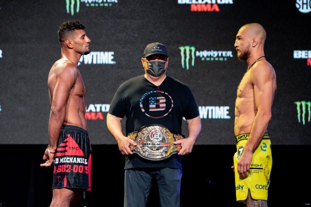 Douglas Lima and Yaroslav Amosov face off while Bellator President Scott Coker holds the Bellator Welterweight Championship.