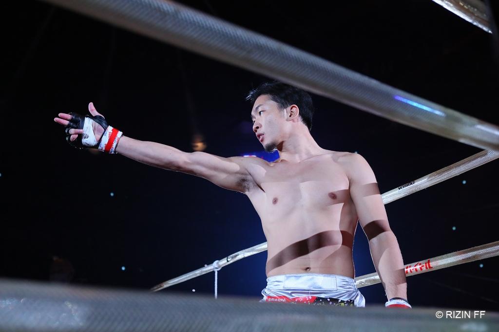 Mikuru Asakura points across the RIZIN ring.
