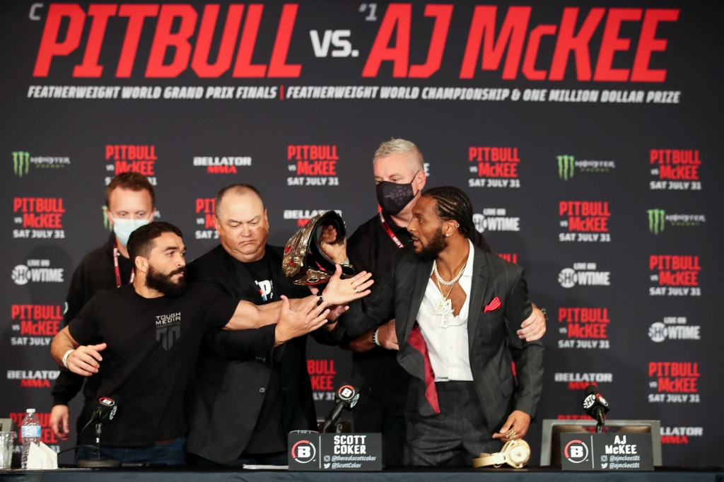 Patricio Pitbull and AJ McKee get in each other's faces at a press conference.