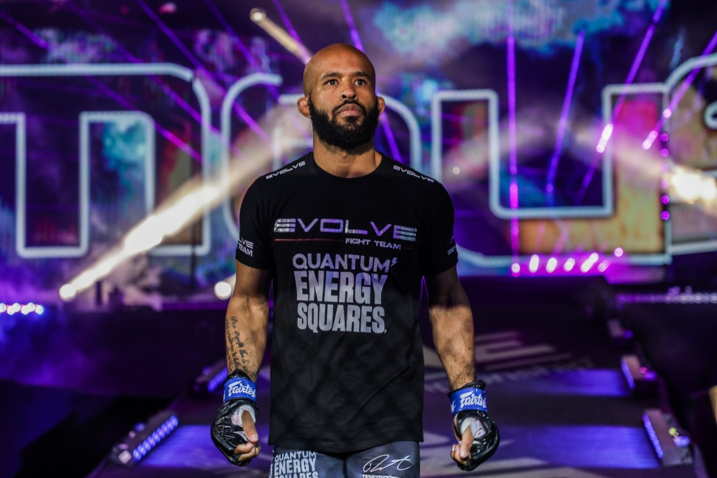 Demetrious Johnson walks down a ramp at a ONE Championship event.